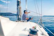 Man enjoying sailing with sailboat