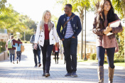 Students Walking Outdoors On University Campus
