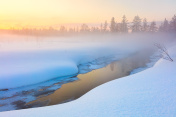 Colorful winter sunset in forest and river with beautiful misty