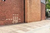 Red brick wall and empty floor sidewalk