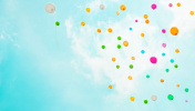 Background with multicolored flying balloons in blue sky