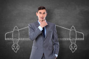 Businessman with drawn aircraft wings