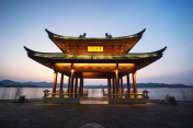 chinese ancient pavilion with sunset at the west lake