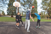 Family Basketball Game at the Park