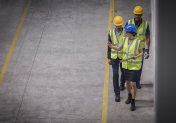 Factory manager and workers walking