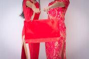 Chinese women friends enjoying shopping, woman wear cheongsam