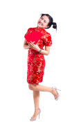 Beautiful Young asian woman wearing chinese dress traditional cheongsam or qipao. Look at and Smile many red envelopes isolated on white background. Chinese New Year Festivities, New Year Celebration