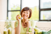 Older woman with healthy food indoors