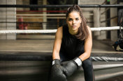 Attractive brunette in a boxing gym