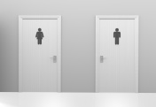 Restroom doors to public toilets with men and women icons