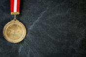 Medal on blackboard