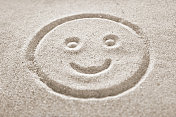 smile face in the sand