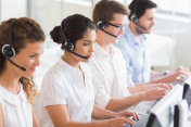 Customer service operators working at desk