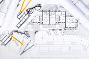Construction plans with drawing Tools on blueprints