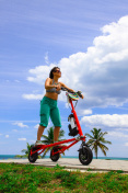 Woman on an electric tricycle in Miami