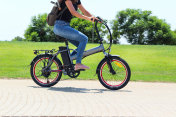 A women riding on electric bicycle in a park