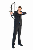 Concentrated handsome businessman practicing archery