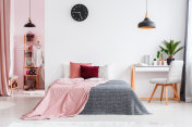 Pink bedroom interior with chair