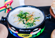 Traditional Bolivian cream peanut soup at a street food market