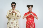 Young chinese new year couple. Chinese new year.