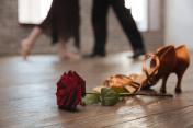 Professional dancers tangoing in the dance studio