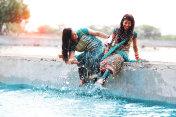 Two woman doing fun in lake water