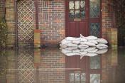 Sandbags near house door during flood