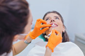 Dentist choose the color of teeth