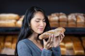 Woman smelling a baguette