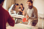 Competition in playing table tennis at casual office!