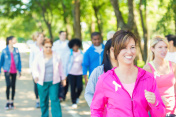 Woman walking in breast cancer awareness charity race event