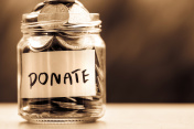 Close up Coins in glass jar for giving and donation