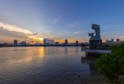 Skyline of da nang by han river with carp dragon in sunset