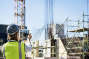 Construction engineer supervising site