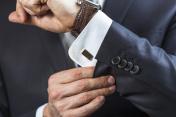 Businessman correcting shirt sleeve