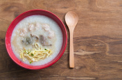 Congee, Rice porridge, Rice gruel, Rice soup on wooden background