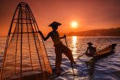 Fishermen on Inle Lake watching the sunset, Myanmar