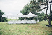 Tables for wedding reception under tent in open air