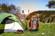 Camping with a backpack and a tent in the mountains.