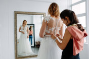 Wedding dress fitting in bridal boutique