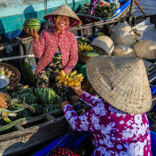 Vietnamese woman selling bananas on floating market, Mekong River Delta, Vietnam