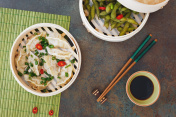 Steamed Dumplings and edamame soybeans in a bamboo steamer