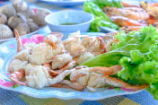 Steamed crabs peeled off and crab meat put it on a plate with other food