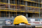 Yellow safety hardhat. Side view
