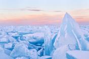 Ice hummock on the ice of lake Baikal on sunset