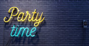 Party time sign on black brick wall background