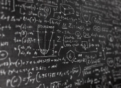Lot of complex math formulas and scientific equations on blackboard