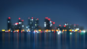 waterfront of city at night blurred