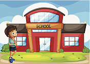 boy in front of the school building