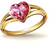 Gold ring with pink heart gemstone.
